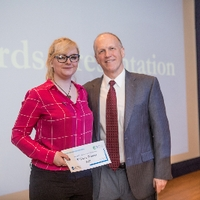 3MT Third Place winner Sarah Thompson with the Dean of the graduate school
